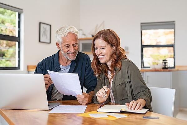 Couple Looking Happy While Budgeting