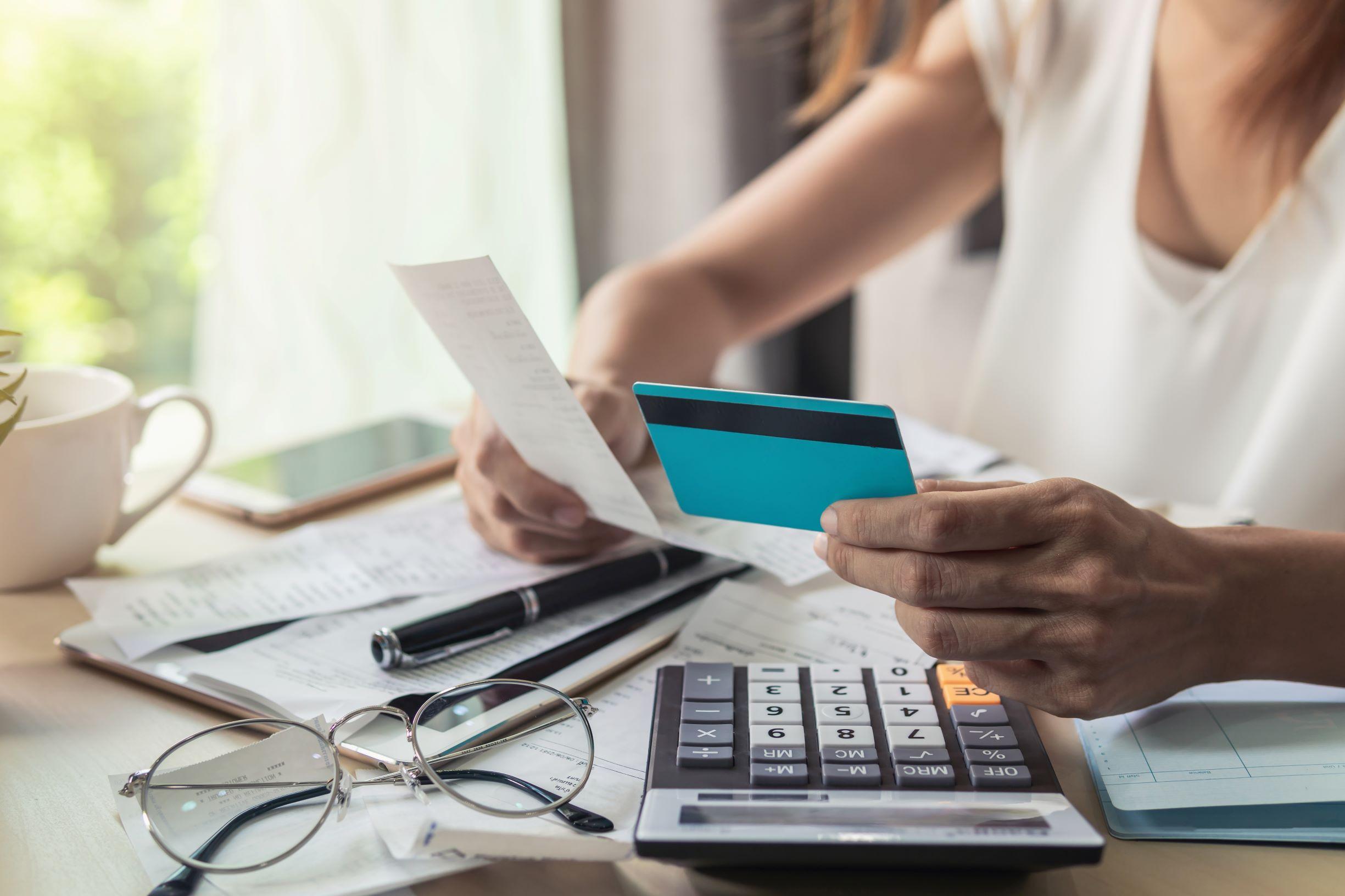Woman calculating credit card bill