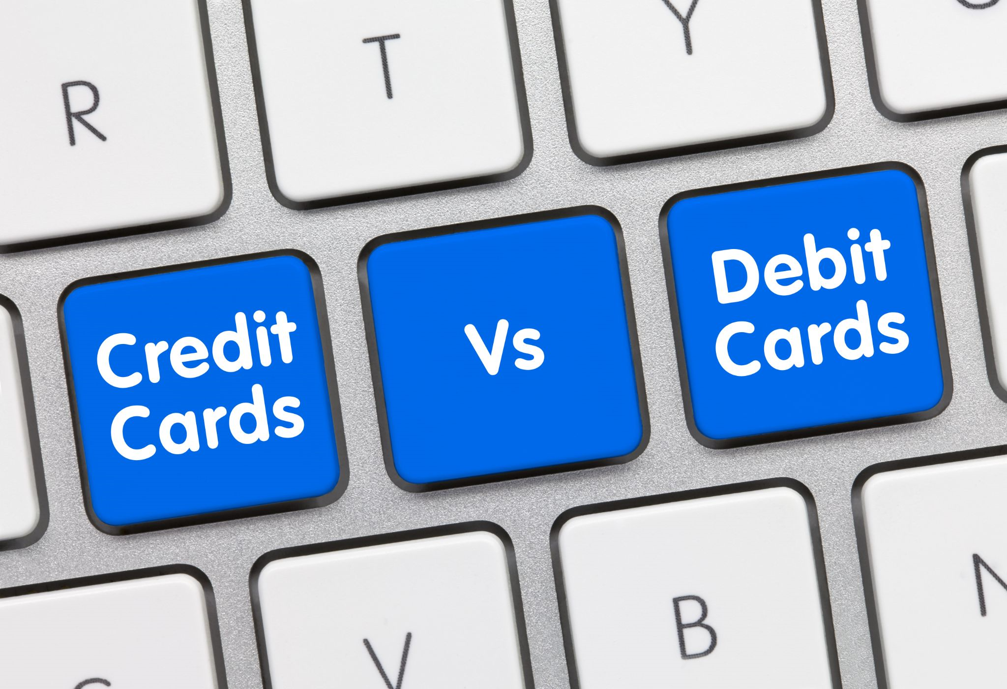 Computer Keyboard with Credit Card vs Debt Card written on keys