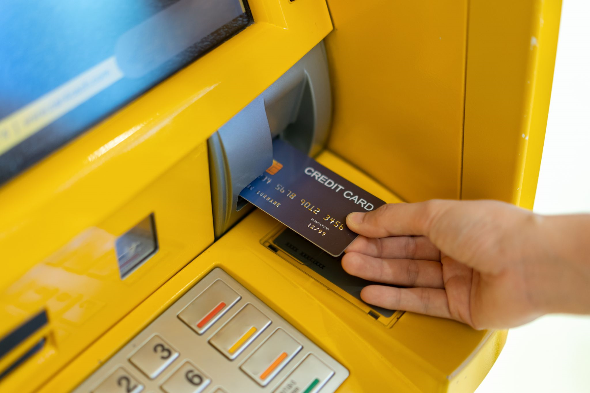 Person using ATM with bank card