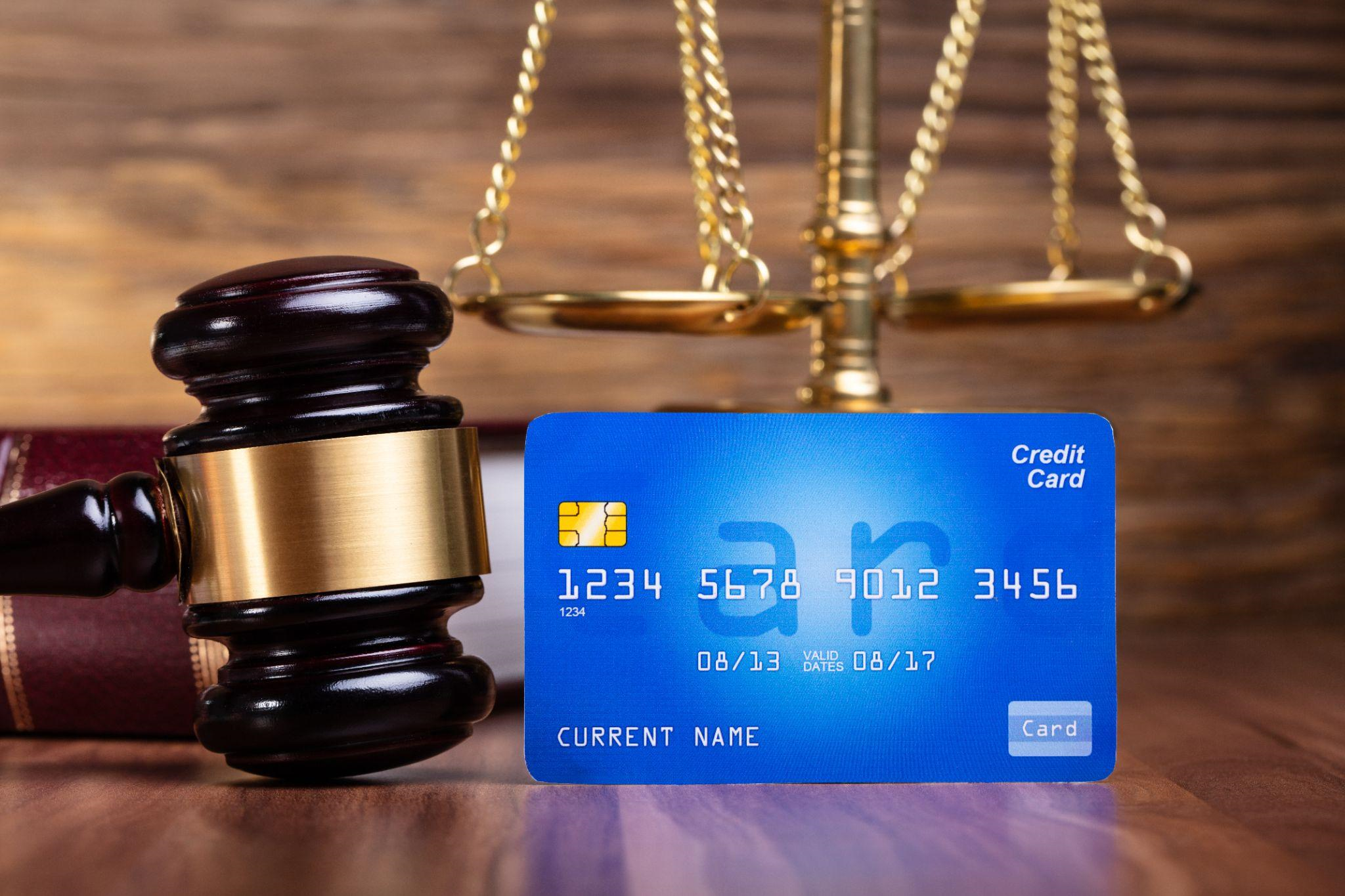 Gavel, scales of balance and credit card image