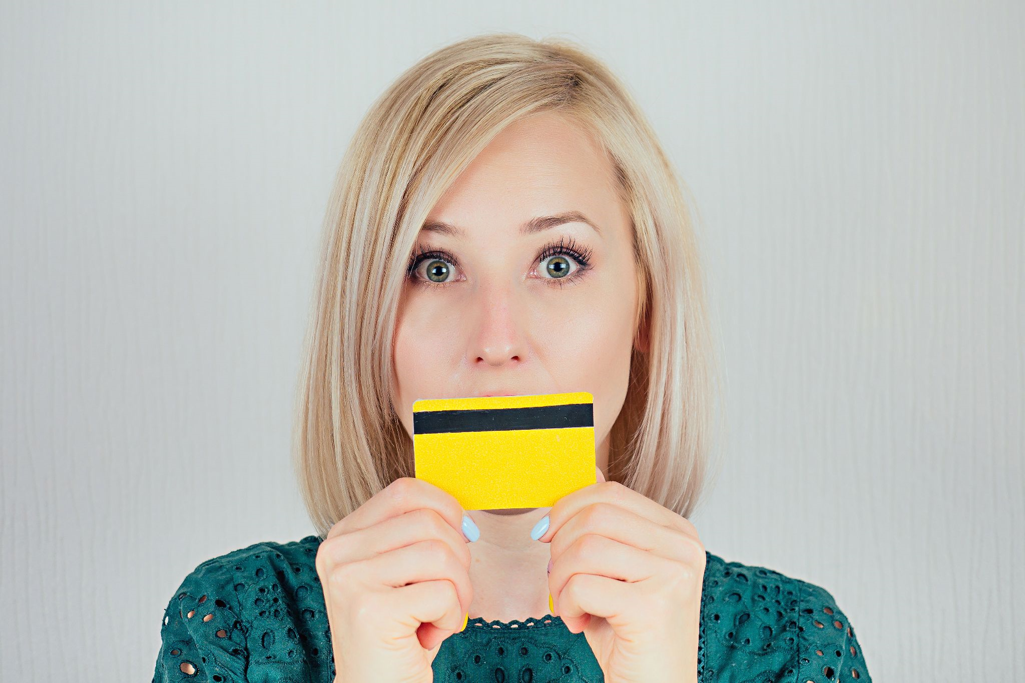 Woman holding a credit a card