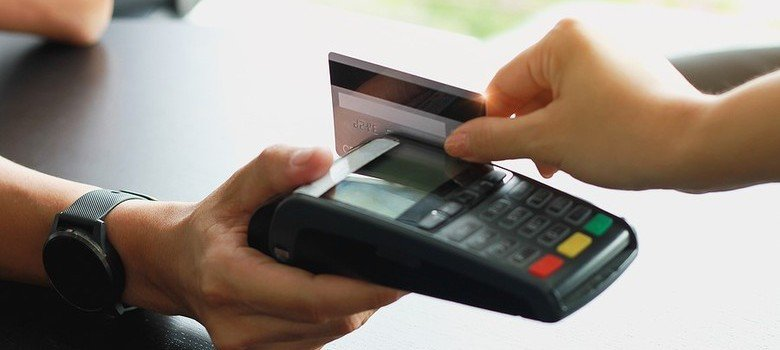 Credit Card being swiped through Credit Card reader