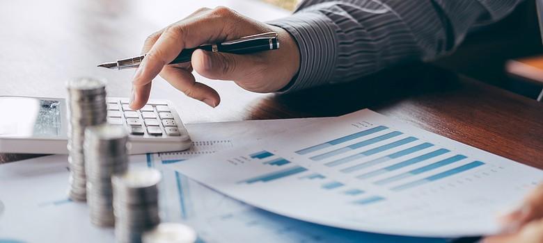 Man looking at chart and calculating debt