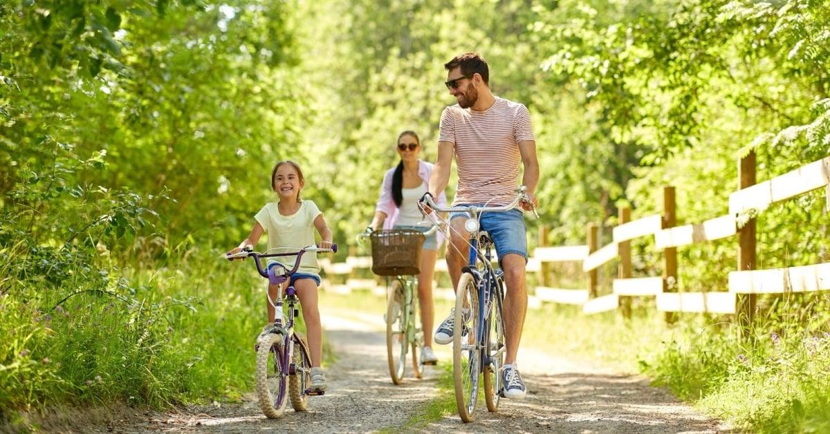 Family biking on a nature path